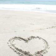 Heart in the sand on Holmes Beach by Lori McGourty